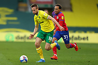 20th March 2021; Carrow Road, Norwich, Norfolk, England, English Football League Championship Football, Norwich versus Blackburn Rovers; Marco Stiepermann of Norwich City takes on Elliott Bennett of Blackburn Rovers