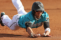 Rico Noel #1 of the Coastal Carolina University Chanticleers sliding into 3rd base head first in a game against the University of Michigan Wolverines at the Carvelle Resort Classic Tournament held at Watson Stadium at Vrooman Field in Conway,, SC on March 13, 2010. Photo by Robert Gurganus/Four Seam Images