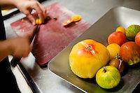 Seven different varieties of tomatoes are prepared for a dish at restaurant Mirazur, Menton, France, 18 September 2013