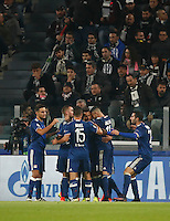 Calcio, Champions League: Gruppo H, Juventus vs Lione. Torino, Juventus Stadium, 2 novembre 2016. <br /> Lyon's Corentin Tolisso, third from right, celebrates with teammates after scoring the equalizer goal during the Champions League Group H football match between Juventus and Lyon at Turin's Juventus Stadium, 2 November 2016. The game ended 1-1.<br /> UPDATE IMAGES PRESS/Isabella Bonotto