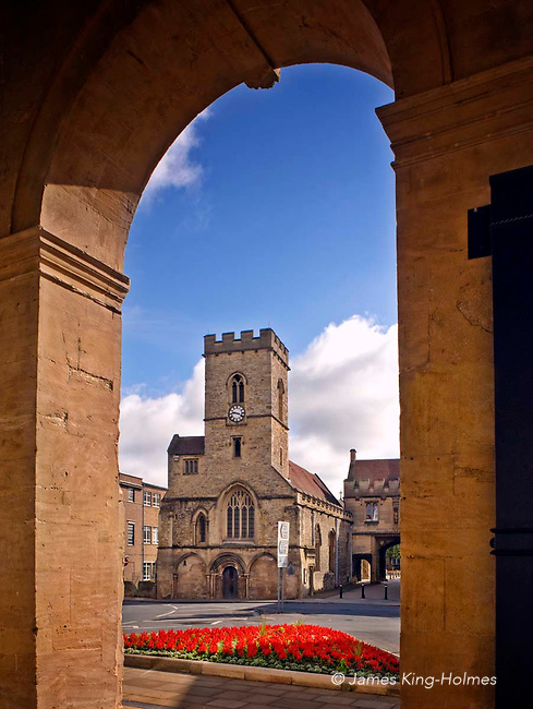 The Church of St Nicholas at Abingdon-on-Thames, seen through one of the arches supporting the County Hall museum, is now a parish church but was originally an outlying church of the medieval Abingdon Abbey built for the monk's servants and tenants.  It has connections with the 12th century Saint Edmund of Abingdon.