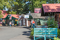Historic log cabins converted to stores selling gifts and food in the Pioneer Park, Fairbanks, Alaska.