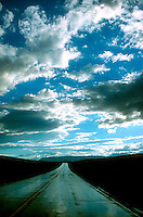 Cloudy sky over roadway<br />