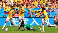 BRASILIA - BRASIL -19-06-2014. Juan Cuadrado (#11), Abel Aguilar (#8) y Camilo Zuñiga (#18) jugadores de Colombia (COL) disputan el balón con Wilfried Bony (#12) jugador de  Costa de Marfil (CIV) durante partido del Grupo C de la Copa Mundial de la FIFA Brasil 2014 jugado en el estadio Mané Garricha de Brasilia./ Juan Cuadrado (#11), Abel Aguilar (#8) and Camilo Zuñiga (#18) players of Colombia (COL) fight the ball with Wilfried Bony (#12) player of Ivory Coast (CIV) during the macth of the Group C of the 2014 FIFA World Cup Brazil played at Mane Garricha stadium in Brasilia. Photo: VizzorImage / Alfredo Gutiérrez / Contribuidor