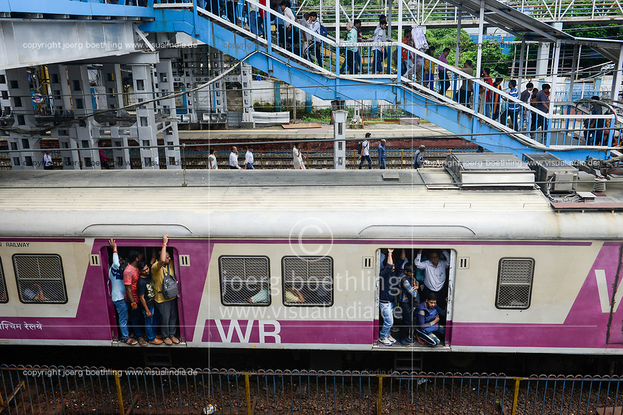 INDIA, Mumbai, suburban Malad, railway station of suburban train Western Railway WR, commuter travel between suburbans and city centre