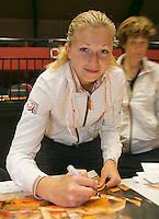 The Netherlands, Den Bosch, 16.04.2014. Fed Cup Netherlands-Japan, Team Netherlands, Michaella Krajicek  signing autographs on posters<br /> Photo:Tennisimages/Henk Koster