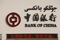 CHINA, autonomous province Xinjiang , Bank of China at people´s Park in city Kashgar where uyghur people are living / CHINA, autonome Provinz Xinjiang , Kashgar, Bank of China, in Xinjiang lebt das Turkvolk der Uiguren