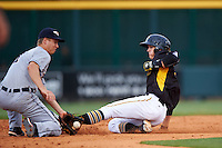 Bradenton Marauders shortstop Kevin Newman (5) slides into second on a stolen base as A.J. Simcox (1) fields the throw down during a game against the Lakeland Flying Tigers on April 16, 2016 at McKechnie Field in Bradenton, Florida.  Lakeland defeated Bradenton 7-4.  (Mike Janes/Four Seam Images)