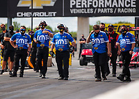 Jul 12, 2020; Clermont, Indiana, USA; Crew members for NHRA top fuel driver Leah Pruett during the E3 Spark Plugs Nationals at Lucas Oil Raceway. This is the first race back for NHRA since the start of the COVID-19 global pandemic. Mandatory Credit: Mark J. Rebilas-USA TODAY Sports