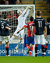 NEIL ALEXANDER FUMBLES FALKIRK'S MARK MILLAR SHOT AS IT GOES IN FOR THE WINNER
