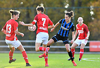Standard's Ellen Charlier (left) pictured in a fight for the ball with Standard's Maurane Marinucci and Charlotte Laridon (15 Brugge) during a female soccer game between Standard Femina de Liege and Club Brugge YLA on the seventh matchday of the 2020 - 2021 season of Belgian Scooore Womens Super League , saturday 14 th of November 2020  in Angleur , Belgium . PHOTO SPORTPIX.BE | SPP | DAVID CATRY
