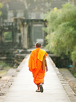 A Buddhist monk walking among the temples of Angkor, Siem Reap Province, Cambodia
