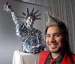 """Artist Juan Lozano with his piece """"Red Bull Nation"""" at the Red Bull Art of Can exhibit opening party at The Galleria Friday July 11,2008."""