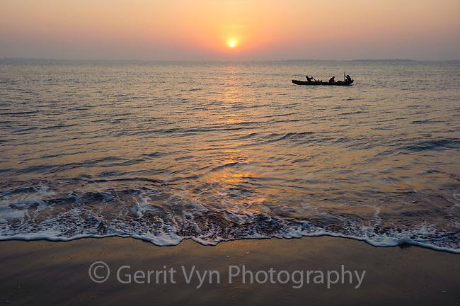 Fishermen rowing at dawn. Rakhine State, Myanmar.