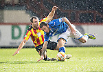 Partick Thistle v St Johnstone....21.01.14   SPFL<br /> Stevie May is tackled by Conrad Balatoni<br /> Picture by Graeme Hart.<br /> Copyright Perthshire Picture Agency<br /> Tel: 01738 623350  Mobile: 07990 594431