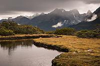 Moody scene with alpine tarn at Key Summit on Routeburn Track, Fiordland National Park, Southland, South Island, UNESCO World Heritage Area, New Zealand, NZ