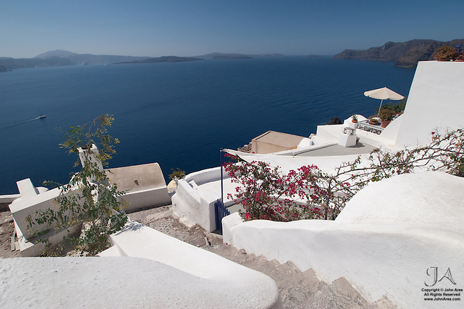 Inviting patio in Oia overlooking the Aegean Sea