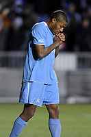 North Carolina Tar Heals Jordan Graye (14) reacts to missing a penalty kick during the penalty kick shootout. The Akron Zips defeated the North Carolina Tar Heals 5-4 in penalty kicks after playing a scoreless game during the second semi-final match of the 2009 NCAA Men's College Cup at WakeMed Soccer Park in Cary, NC on December 11, 2009.