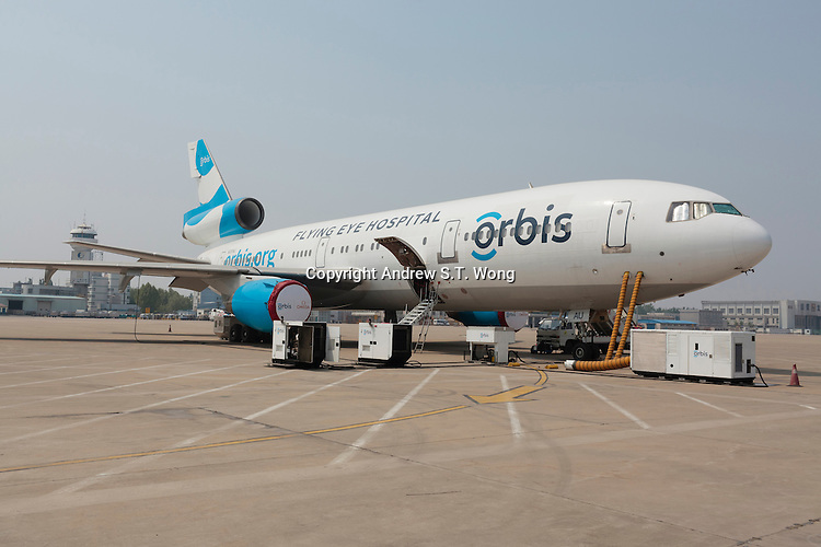 The Orbis Flying Eye Hospital (FEH) sits on the tarmac at Jinan International Airport, April 24, 2014. The FEH was visiting Jinan for the second time to conduct operations, training and skills exchange. China accounts for about 18 percent of the world's blind. China accounts for about 18 percent of the world's blind.