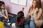 Education Preschool Head Start Early Learn 2s Program teacher and 2 children in class