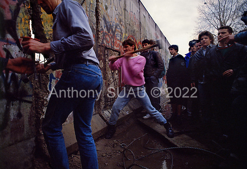 Berlin, Germany<br /> November 11, 1989<br /> <br /> A group of West Germans break through the wall near the Brandenburg Gate. The East German government lifts travel and emigration restrictions to the West on November 9, 1989.