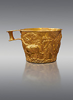Vapheio type Mycenaean gold cup depicting a wild bull hunt , Vapheio Tholos Tomb, Lakonia, Greece. National Archaeological Museum of Athens. <br /> <br />  Two masterpieces of Creto - Mycenaean gold metalwork were excavated from a tholos tomb near Lakonia in Sparta in 1988. Made in the 15th century BC, the gold cups are heavily influenced by the Minoan style that was predominant in the Agean at the time. The bull hunt was popular with  Mycenaean  and Minoan artists and symolised power and fertility. The distinctive shape of the cup is kown as 'Vapheio type'.