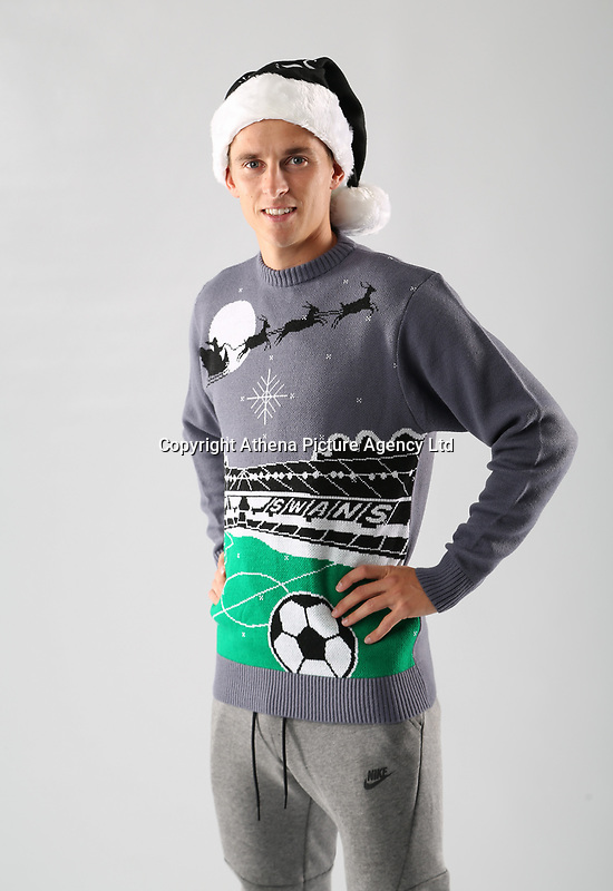 Pictured: Tom Carroll<br /> Swansea City FC and Ospreys RFC Christmas photo shoot at the Fairwood Trainining Ground, near Swansea, Wales, UK. 17 October 2017