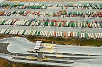 Aerial photography of the Norfolk Southern's Intermodal Facility in Charlotte, NC. The Charlotte Regional Intermodal Facility at CLT is 170-acre site between two runways at Charlotte Douglas International Airport. The new yard has a current capacity for 140,000 containers a year, and it could expand to 200,000.The intermodal hub links air, rail and truck to east coast seaports. <br /> <br /> Charlotte Photographer - PatrickSchneiderPhoto.com