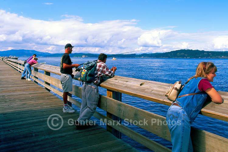 "Fishing on ""Discovery Pier"", overlooking Discovery Passage, in Campbell River, Vancouver Island, British Columbia, Canada"
