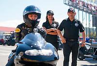 Sep 15, 2019; Mohnton, PA, USA; NHRA pro stock motorcycle rider Jianna Salinas with father Mike Salinas and mother Monica Salinas during the Reading Nationals at Maple Grove Raceway. Mandatory Credit: Mark J. Rebilas-USA TODAY Sports