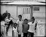 Local residents of Nassau, Bahamas hangout and play in the street.