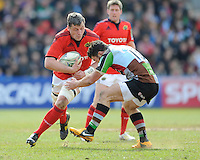 James Coughlan of Munster Rugby is tackled by George Lowe of Harlequins during the Heineken Cup quarter final match between Harlequins and Munster at the Twickenham Stoop on Sunday 7th April 2013 (Photo by Rob Munro)