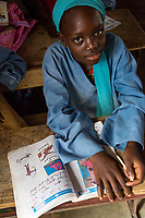 Senegal, Touba.  Young Girl at Al-Azhar Madrasa, a School for Islamic Studies.  Her book shows that she is learning Arabic.