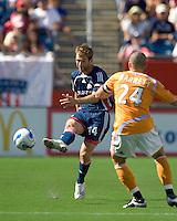 New England Revolution (14) Steve Ralston passes around Houston Dynamo (24) Wade Barrett. The New England Revolution and the Houston Dynamo played to a 3-3 tie in an MLS regular season match at Gillette Stadium, Foxbourgh, MA, on July 22, 2007.