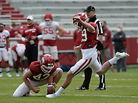 Arkansas kicker Cameron Little (right) kicks Saturday, April 3, 2021, from the hold by Sam Loy during a scrimmage at Razorback Stadium in Fayetteville. Visit nwaonline.com/210404Daily/ for today's photo gallery. <br /> (NWA Democrat-Gazette/Andy Shupe)