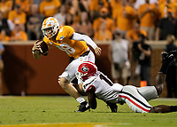 KNOXVILLE, TN - OCTOBER 5: Azeez Ojulari #13 of the Georgia Bulldogs tackles Brian Maurer #18 of the Tennessee Volunteers during a game between University of Georgia Bulldogs and University of Tennessee Volunteers at Neyland Stadium on October 5, 2019 in Knoxville, Tennessee.
