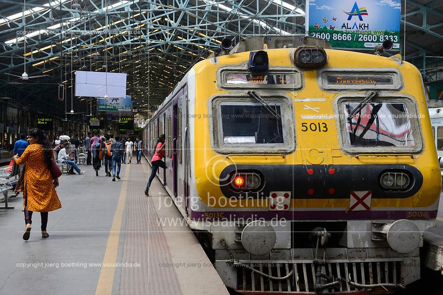 INDIA, Mumbai, Churchgate railway station for suburban train Western Railway WR, commuter travel between suburbans and city centre