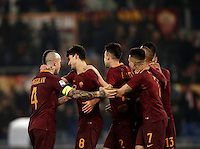 Calcio, Serie A: Roma vs ChievoVerona. Roma, stadio Olimpico, 22 settembre 2016.<br /> Roma's Diego Perotti celebrates with teammates after scoring on a penalty kick during the Italian Serie A football match between Roma and Chievo Verona, at Rome's Olympic stadium, 22 December 2016.<br /> UPDATE IMAGES PRESS/Isabella Bonotto