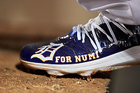 "A detailed look at Mesa Solar Sox pitcher Alex Lange's (32) custom cleats during an Arizona Fall League game against the Peoria Javelinas on September 21, 2019 at Sloan Park in Mesa, Arizona. Lange's cleats were painted with ""For Numi"" to honor his late teammate Chace Numata who passed on September 2, 2019. Mesa defeated Peoria 4-1. (Zachary Lucy/Four Seam Images)"