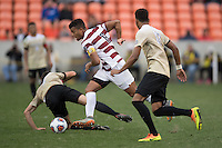 Houston, TX -  Sunday, December 11, 2016:  Brian Nana-Sinkam (8) of the Stanford Cardinal brings the ball up the field against the Wake Forest Demon Deacons at the  NCAA Men's Soccer Finals at BBVA Compass Stadium.