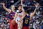 Real Madrid's Sergio Llull and FC Barcelona Lassa's Brad Oleson and Victor Faverani during Liga Endesa match between Real Madrid and FC Barcelona Lassa at Wizink Center in Madrid, Spain. March 12, 2017. (ALTERPHOTOS/BorjaB.Hojas)