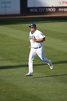 Brandon Wulff (29) of the Rancho Cucamonga Quakes runs before a game against the Stockton Ports at LoanMart Field on May 26, 2021 in Rancho Cucamonga, California. (Larry Goren/Four Seam Images)
