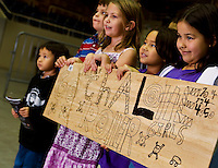Fans watch a Charlotte Roller Derby Girls event at Bojangles Arena in Charlotte, NC.