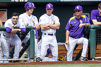LSU Tigers players Chris Chinea (26), Alex Bregman (8) and coaches Alan Dunn and Paul Mainieri in the dugout during the game against the TCU Horned Frogs in the NCAA College World Series on June 14, 2015 at TD Ameritrade Park in Omaha, Nebraska. TCU defeated LSU 10-3. (Andrew Woolley/Four Seam Images)