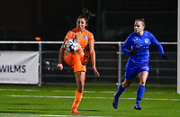 Jolet Lommen (9) of AA Gent pictured in front of Luna Vanhoudt (43) of KRC Genk during a female soccer game between  Racing Genk Ladies and AA Gent Ladies on the eleventh matchday of the 2020 - 2021 season of Belgian Scooore Womens Super League , friday 22 th of January 2021  in Genk , Belgium . PHOTO SPORTPIX.BE   SPP   DAVID CATRY