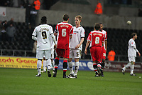Pictured: (L-R) Jason Scotland and Alan Tate of Swansea City in action <br /> Re: Coca Cola Championship, Swansea City FC v Charlton Athletic at the Liberty Stadium, Swansea, south Wales. 28 February 2009<br /> Picture by D Legakis Photography / Athena Picture Agency, Swansea 07815441513