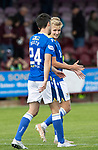 Arbroath v St Johnstone…15.08.21  Gayfield Park      Premier Sports Cup<br />Ali McCann celebrates his penalty kick with Callum Booth that won the game for saints<br />Picture by Graeme Hart.<br />Copyright Perthshire Picture Agency<br />Tel: 01738 623350  Mobile: 07990 594431