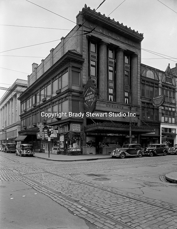 Pittsburgh PA:  View of the corner of Diamond and Wood Streets.  Founded in 1832 in a log cabin, John M. Roberts & Son Co. moved to Wood and Diamond streets in 1925. Mr. Roberts was the fourth generation of his family to work in the business. Owners often said it was the oldest emporium in Pittsburgh, the first to use lighting in its display windows, and proudly boasted of customers such as George Westinghouse, railroad financier and philanthropist Diamond Jim Brady, singer Lillian Russell, and pianist Liberace.<br /> The store closed in 1997 when the building was sold to a convenience store chain, but, at its peak, the company employed 63 people on four floors.