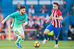Lionel Andres Messi (l) of FC Barcelona battles for the ball with Saul Niguez Esclapez of Atletico de Madrid during their La Liga match between Atletico de Madrid and FC Barcelona at the Santiago Bernabeu Stadium on 26 February 2017 in Madrid, Spain. Photo by Diego Gonzalez Souto / Power Sport Images