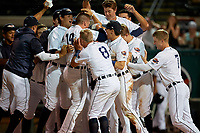 Lakeland Flying Tigers Austin Athmann (19) is mobbed by teammates after a game winning home run during a Florida State League game against the Palm Beach Cardinals on April 17, 2019 at Publix Field at Joker Marchant Stadium in Lakeland, Florida.  Lakeland defeated Palm Beach 1-0.  (Mike Janes/Four Seam Images)